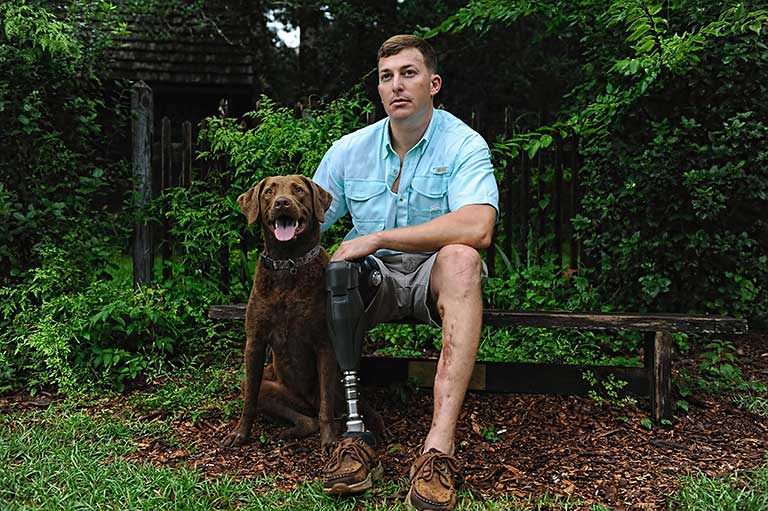 Photo of a Wounded Warrior and His Dog